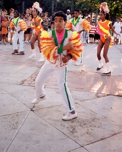 A dance troup performing on a street in Cuba.
