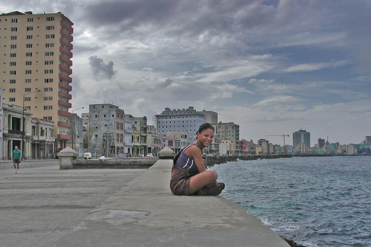 Cubana sitting on el malecon