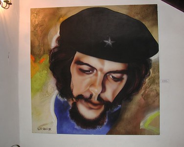 Statues, Images and Impressions from Cuba  - Painting of Che located just outside an exhibit of Che's Office.