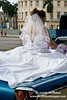 A bride being delivered to her reception in Havana.