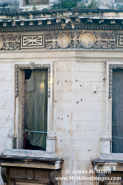 Bullet holes from The Revolucion still visible in the granite facade.