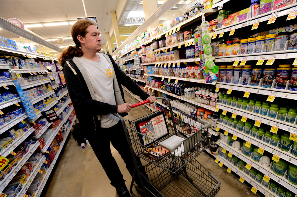 . Mitchell Elder, with Cultivate, shops for food for homebound seniors at the King Soopers on Table Mesa Drive in Boulder  on Thursday.  For more photos go to dailycamera.com Paul Aiken / Staff Photographer / May 17, 2018