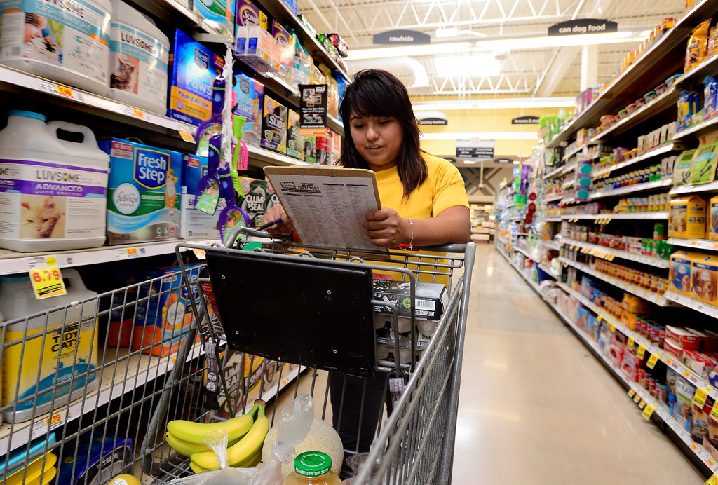 . Ruby Zavala, a Program Coordinator with Cultivate, shops for food for homebound seniors at the King Soopers on Table Mesa Drive in Boulder  on Thursday.  For more photos go to dailycamera.com Paul Aiken / Staff Photographer / May 17, 2018