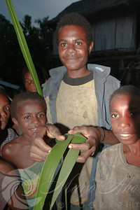 This young man showed us how to weave balls out of palm fronds. I showed him how to turn the balls into poi by adding some twine. Soon every kid and quite large part of the adult population of the village was playing poi with me. Hands down the most fun poi session of my life.