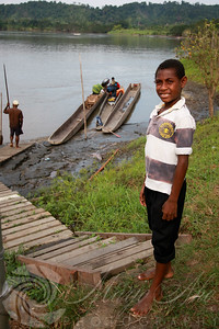 Loading up the canoe after a night in Ambunti with help from Valentine and Angela's son.