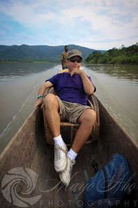 Scott at the beginning of the trip in the still quite comfortable cane chair. George steering the canoe at the aft.
