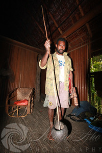 George holding the water scoopy which the women use to haul water from the river to pour through the sago pulp so filter out the starch.