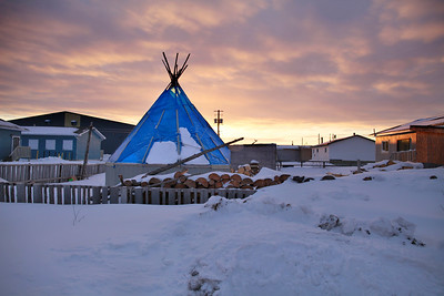 Sun sets behind an Attawapiskat family teepee, used for larger family gatherings.