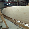 Planked with white cedar strip core. <br /> Stem has conventional profile due to owner's preference.
