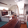 Main cabin looking aft. Galley to stb. Refer box and nav/com to port.