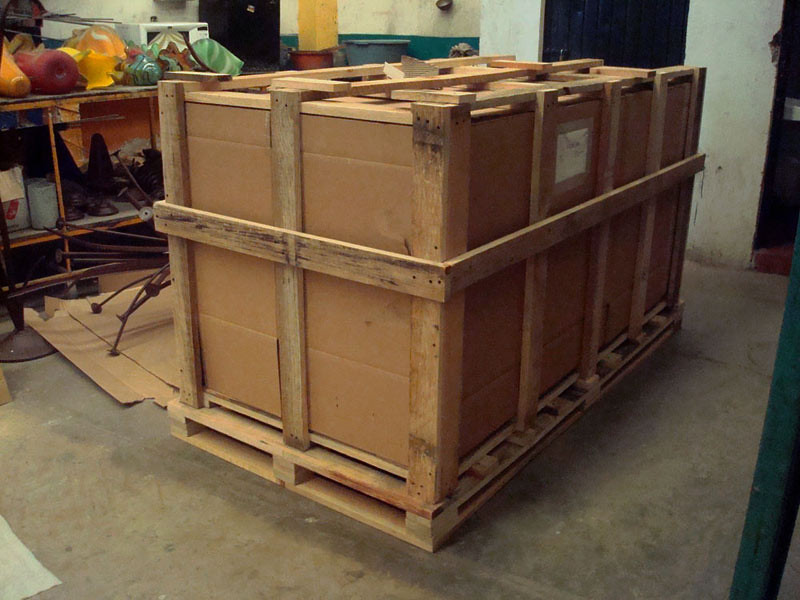 This is the crate with the bathtub and frames and sinks packed inside the bathtub. Before it is shipped, the crate will be strapped to the pallet. This is what it should look like when you pick it up (with the straps around it). It weighs about 500 lbs. The warehouse has a forklift so they will be able to place it in your truck.
