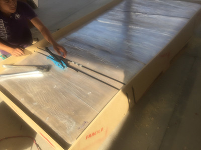 This photo shows how the table top is secured within the crate. It is packed so the table top does not move.