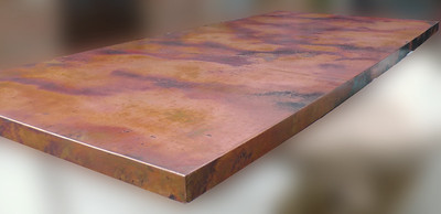 This photo was taken before the copper lamina is high polished to minimize reflection for the photo.
