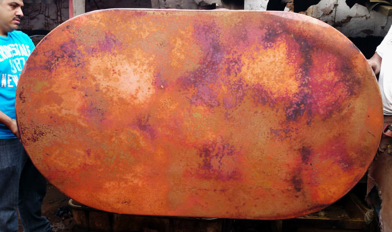 This is the patina cruda. It has not had the wax applied yet. When the wax is applied, the colors will be more muted and blend together. It is a very nice patina with very little black.