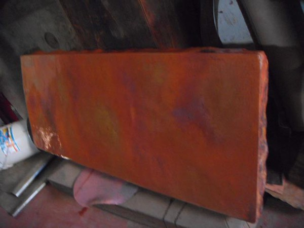 "This angle shows the patina coloration as ""quieter"". Copper is highly reflective. The lighting makes a big difference."