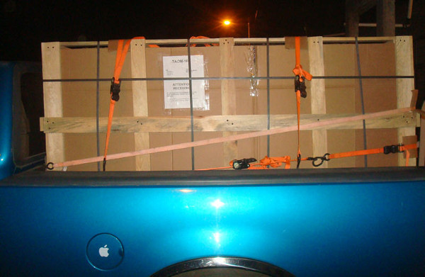 The packer took this photo after the crate was loaded into his truck. But, you can still see what it is supposed to look like when you receive it (minus the orange straps).