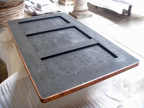 This is the substrate. The horizontal supports are screwed in, not glued in. When you unpack the table top, remove the horizontal bars as the iron base has the horizontal supports. You will screw the iron base supports into the table substrate.