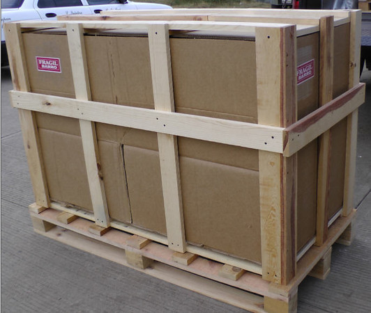 This is the crate that was built for the base. It is sitting on a pallet. When this photo was taken, the base had not been put into the crate and it was not strapped together. When you receive it, there will be straps on it holding the pallet to the crate.