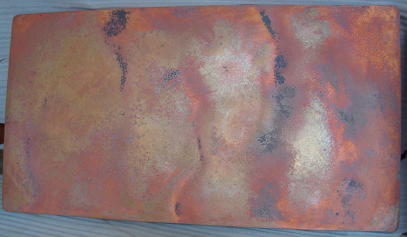 Larry, this is the copper table top as it looks coming out of the fire. No wax has been applied to bring out the colors, but with imagination you can get an idea of what it will look like after it is waxed. Do you like it?