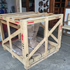 The crate is 53x53x46 inches and weighs 315 lbs.