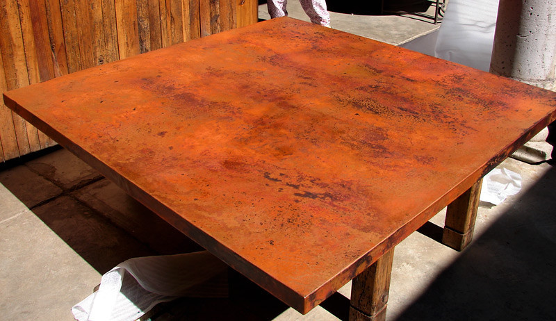 The table top has been waxed. The next photo shows a close up of the patina. It is truly beautiful! This photo on my monitor shows the patina a bit more orange than it really is.