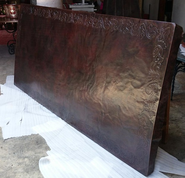 "This is your 106"" x 48"" x 2"" copper table top with the dark brown patina colaor before being mounted on the substrate. Looks very good, Mr. Samma. It was quite a job getting a table top this size to have a consistent color patina because it has to be heated to a consistent temperature. They did it! Copper is highly reflective; thus, the greyish tone at the bottom reflecting the white foam it is sitting on."
