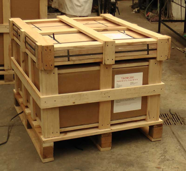 This is the coffee table base with the table top crate on top of the base with both sitting on the pallet. When this photo was taken, the 3 pieces had not been strapped together yet. When  you receive the shipment, it should look like this with the straps, of course.
