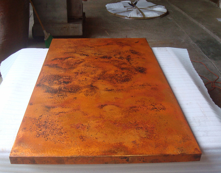 Rectangular table #1 - Your two rectangular table tops are similar, but not identical, as can be expected. The natural patina will age beautifully. To protect the patina, wax it when water no longer beads on the surface. We use Johnson's paste wax.