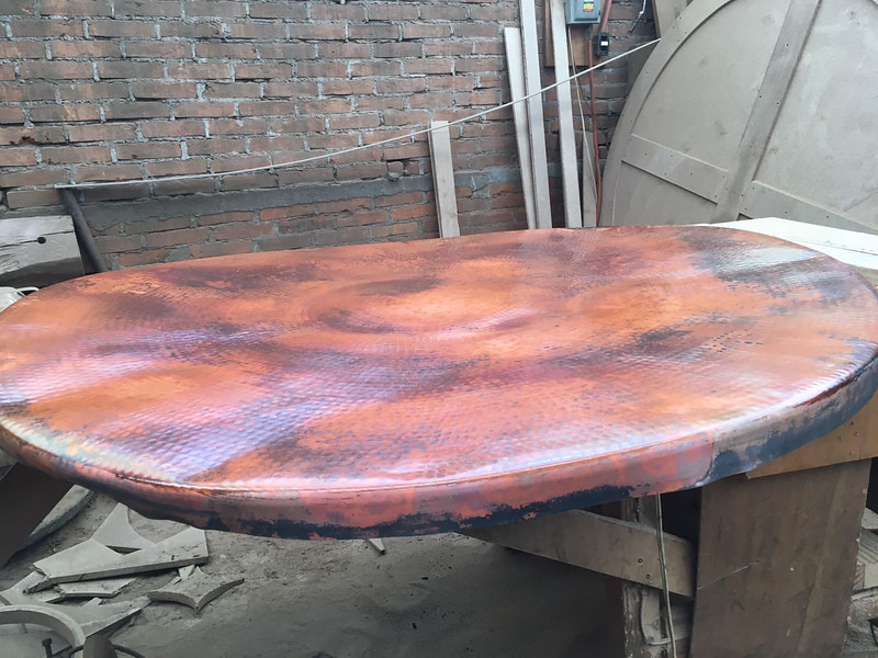 The lamina has not yet been attached to the wood substrate. The purpose of these photos is for you to approval the color tones. When attached to the substrate and high polished; the colors will blend together to create a beautiful copper canvas of colors.