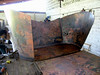 (1) The panels that form the tub are cut from patterns. The panels are then curved to fit the bottom form using fire, and then welded to form the tub.