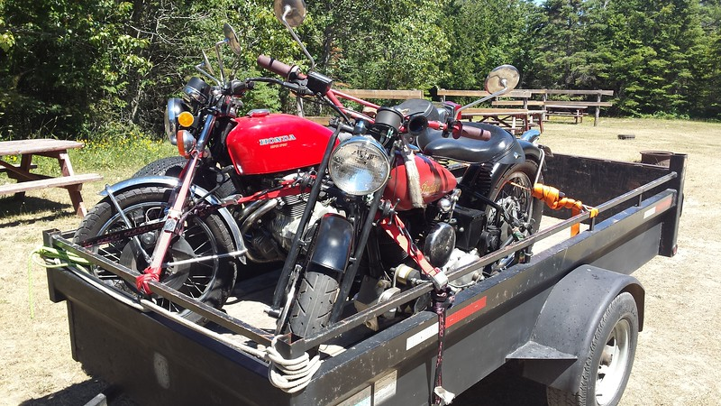 Pete Dopson's Indian Scout and Dan Farrow's CB400 arrive on Pete's trailer.