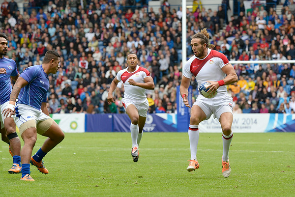 July 27, 2014 - Rugby Sevens - Samoa vs. England in the Quarter finals during the Rugby Sevens at the 20th Commonwealth Games in Glasgow, Scotland.<br /> <br /> Michael Ellery (#2) of England after receiving the kick-off at the beginning of the game. <br /> <br /> Final score of the game was Samoa 15 and England 14.<br /> <br /> If you have any questions don't hesitate to reach out to us!<br /> <br /> Thanks!<br /> <br /> Photos by Al Milligan, Al Milligan Images, 2014