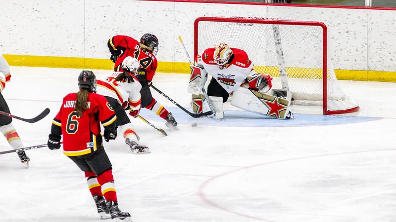 October 20, 2018 - Winsport, Calgary, AB - Calgary Inferno Brianna Decker (#14) scores on Vanke Rays goalie Noora Raty (#41) duringthe second period.