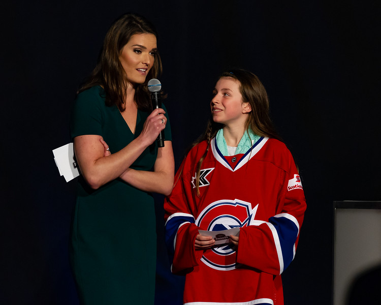 TORONTO, ON - March 22, 2019: Awards ceremony host Caroline Cameron having fun with one of the special assistant hosts. The Mattamy Centre of Ryerson University hosted the 2019 edition of the CWHL Awards Ceremony.
