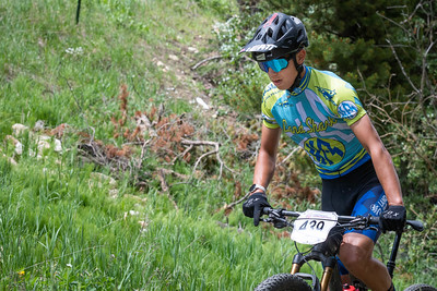 Mountain Bike National Championships - Non-championship race - a rider out of teh saddle on the climb.