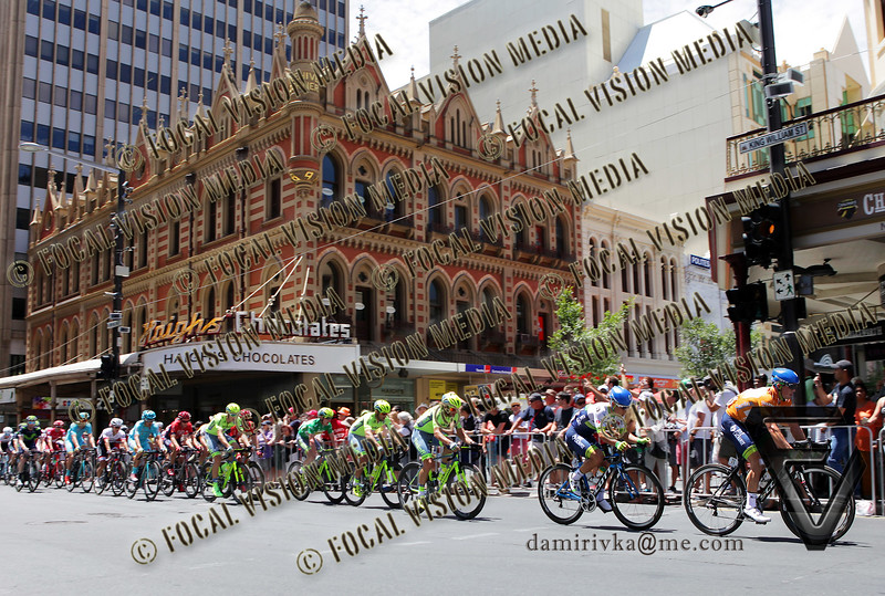 2016 Santos Tour Down Under . MAC Stage 6 Adelaide. Australia.Sunday 14/01/2016.<br /> #11 Simon GERRANS (Aus) riding for Orica Green Edge Team (Aus) is the 2016 Overall Winner.<br /> Here with his team mate and stage winner Caleb Ewan (Aus) as they pass Haigh's Chocolates in King William Street.<br /> © ATP / Damir IVKA