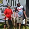 Keith Reynolds — The Morning Journal <br> Erick Williams, of Hubbard, left, and Sammy Cappelli, of Poland, holding four of the fish that helped them clinch their win at the Cabela's National Team Championship walleye tournament June 10 at Black River Landing in Lorain.