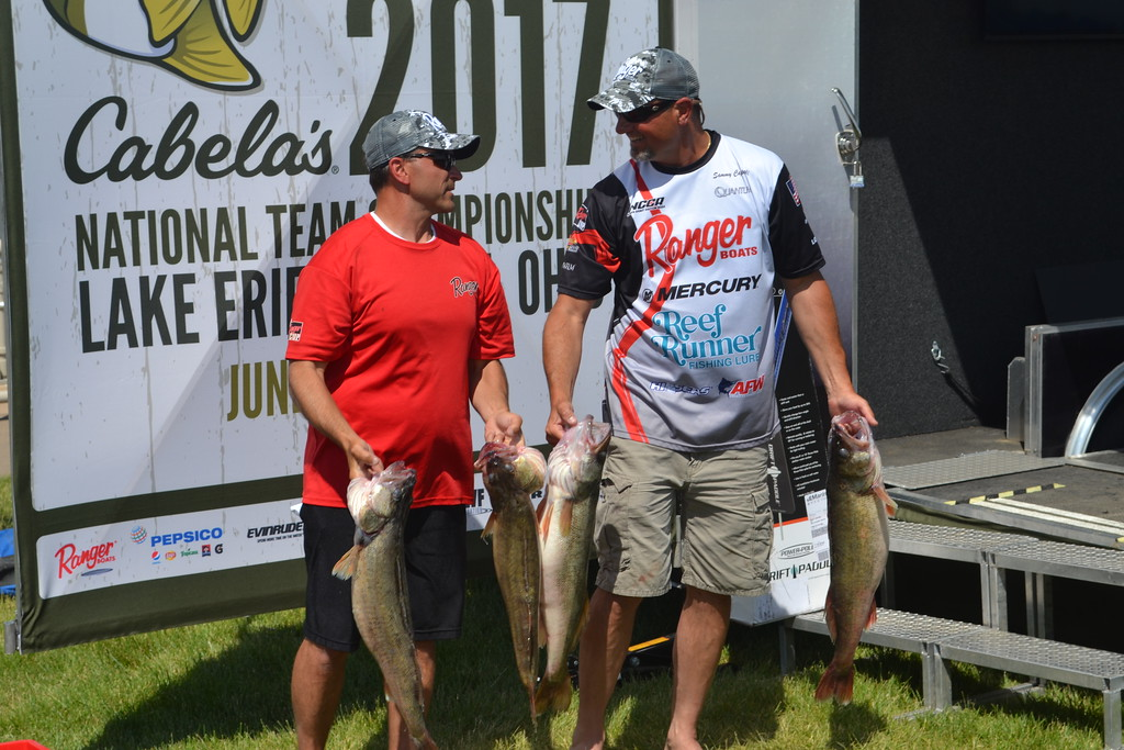 . Keith Reynolds � The Morning Journal <br> Erick Williams, of Hubbard, left, and Sammy Cappelli, of Poland, holding four of the fish that helped them clinch their win at the Cabela�s National Team Championship walleye tournament June 10 at Black River Landing in Lorain.