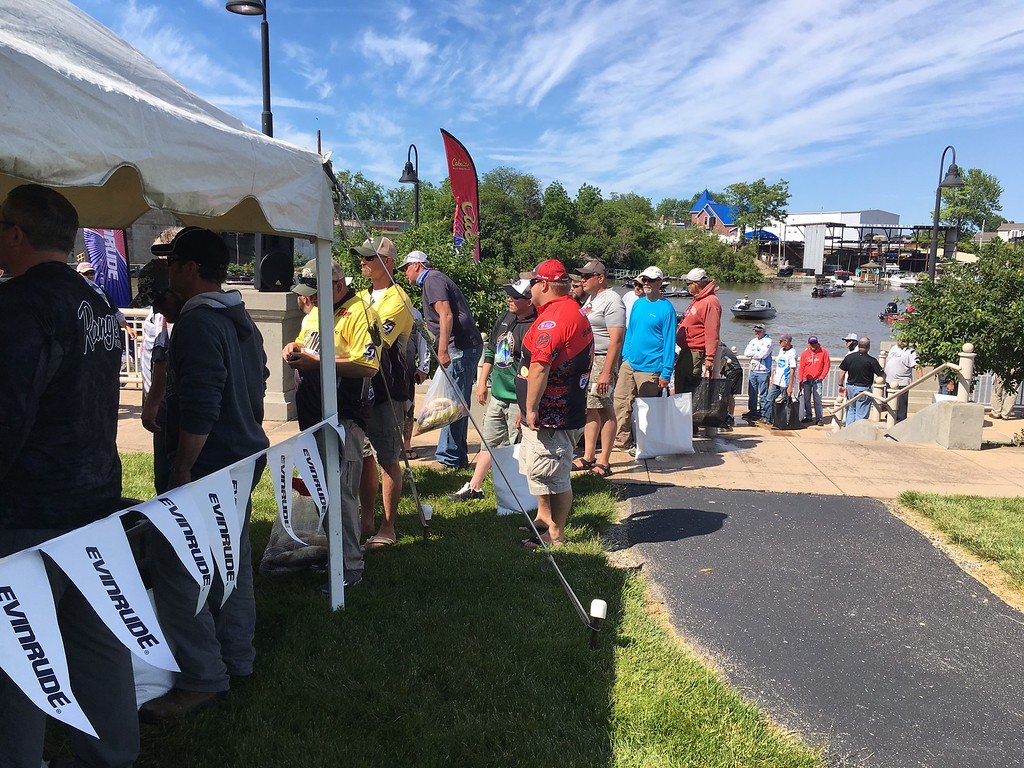 . Richard Payerchin � The Morning Journal <br> Anglers line up to bring their fish into the check-in station for weighing on June 8, 2017, in the Cabela\'s National Team Championship walleye tournament in Lorain. The three-day contest continues June 9 and 10.