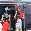 Keith Reynolds — The Morning Journal <br> Erick Williams, of Hubbard, left, and Sammy Cappelli, of Poland, hoist trophies they received for their win at the Cabela's National Team Championship walleye tournament June 10 at Black River Landing in Lorain.