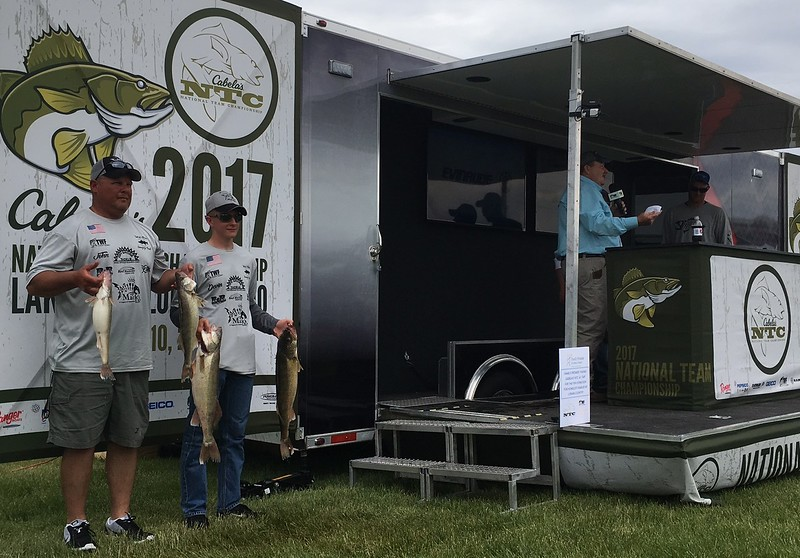 Richard Payerchin — The Morning Journal <br> Father-son team of anglers John Stalling of Kenton, left, and Devin Stalling pose for photos with their catch at the Cabela's National Team Championship walleye tournament in Lorain on June 9, 2017.