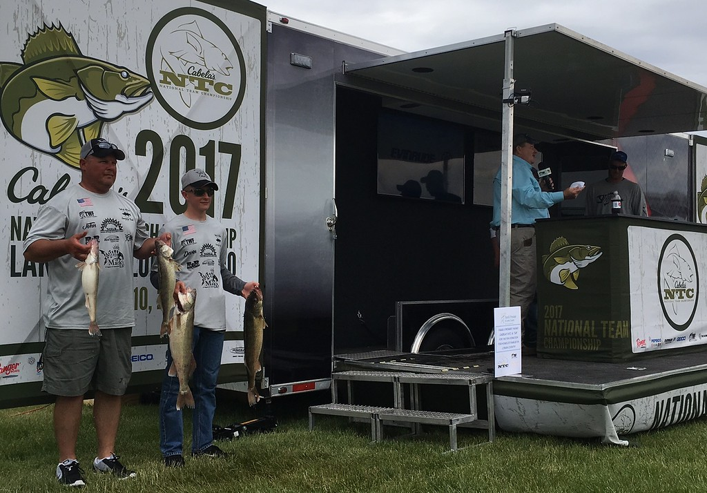 . Richard Payerchin � The Morning Journal <br> Father-son team of anglers John Stalling of Kenton, left, and Devin Stalling pose for photos with their catch at the Cabela\'s National Team Championship walleye tournament in Lorain on June 9, 2017.