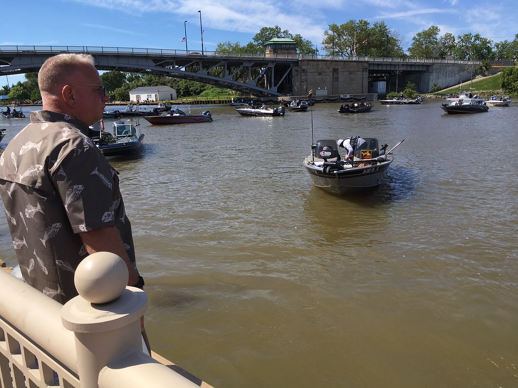 . Richard Payerchin � The Morning Journal <br> Lorain Port Authority Executive Director Tom Brown looks out as fishing boats arrive at Black River Landing on June 8, 2017, in the Cabela\'s National Team Championship walleye tournament in Lorain. The three-day contest continues June 9 and 10.