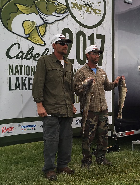 . Richard Payerchin � The Morning Journal <br> Anglers Dan Smith of Avon, left, and Joe Zelei of Clinton pose for photos with their catch at the Cabela\'s National Team Championship walleye tournament in Lorain on June 9, 2017.