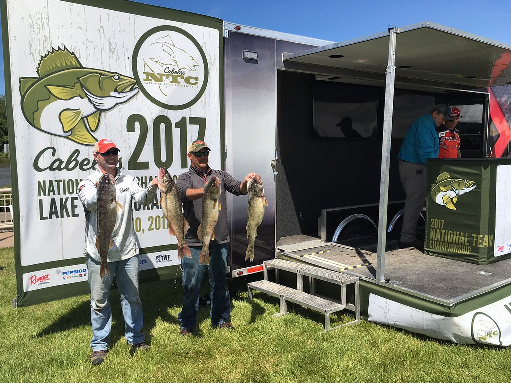 . Richard Payerchin - The Morning Journal <br> Anglers Andrew Johnson, left, and Curt Hanson of North Dakota hold up their catch on June 8, 2017, in the Cabela\'s National Team Championship walleye tournament in Lorain. The three-day contest continues June 9 and 10.