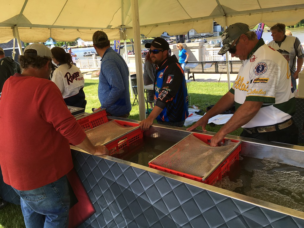 . Richard Payerchin � The Morning Journal <br> Anglers use plastic baskets to keep their catch fresh as they wait in the weigh-in line on in the Cabela�s National Team Championship walleye tournament in Lorain. The three-day contest continues June 9 and 10.