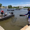 Richard Payerchin — The Morning Journal <br> An angler extends a landing net as Tiffany McClelland, right, gets ready to hand off a fish bag on June 8, 2017, in the Cabela's National Team Championship walleye tournament at Black River Landing in Lorain. The three-day contest continues June 9 and 10.