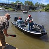 Richard Payerchin — The Morning Journal <br> Lorain Port Authority Executive Director Tom Brown gets ready to toss over a fish bag to one of the teams in the Cabela's National Team Championship walleye tournament at Black River Landing in Lorain. The three-day contest started June 8, 2017, continues June 9 and 10.