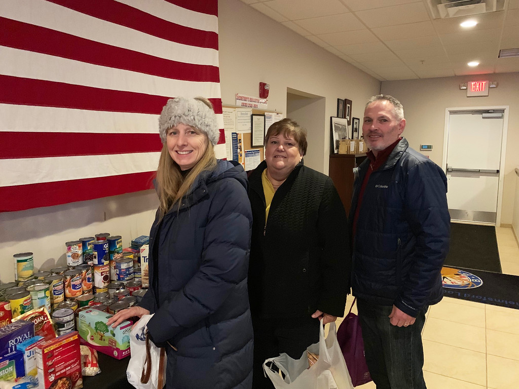 . Generous guests drop off donations for the Chelmsford and Westford food pantries.