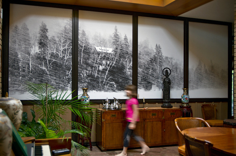 "The single photo, ""Cabin in a blizzard"", is now a 16-foot mural in a NC Mid-century home.  In addition to tweaking the contrast, I did a horizontal flip to put the center of interest in the second panel and brighten the darker area of the dining room with the mass of sky and snow of the fourth panel. <br /> Installation July 28, 2010."